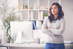 Female entrepreneur. Confident female entrepreneur standing in her office Royalty Free Stock Photography