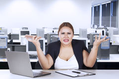 Female entrepreneur confused with her job Stock Image