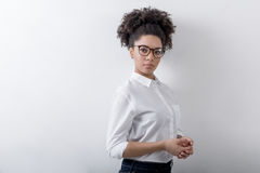 Female entrepreneur with curly hair and eyeglasses. Copy space Royalty Free Stock Photo
