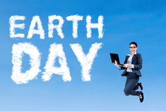 Female entrepreneur and Earth Day text Royalty Free Stock Image