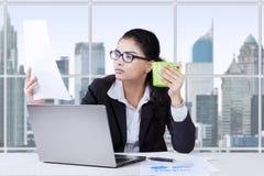 Female entrepreneur enjoy coffee while working Royalty Free Stock Image