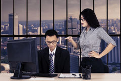 Female entrepreneur feels angry to her subordinate. Portrait of female entrepreneur feels angry to her subordinate while stands in the office Stock Images