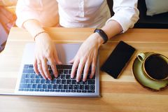 Female entrepreneur Manager using her laptop , working in a cafe or office. Near mobile phone and coffee. Freelance workplace, royalty free stock photos