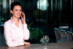 Female entrepreneur in middle of conversation Stock Photography