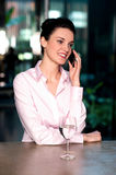 Female entrepreneur in middle of conversation Royalty Free Stock Photos