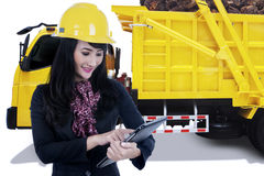 Female entrepreneur with palm fruit on the truck Royalty Free Stock Image