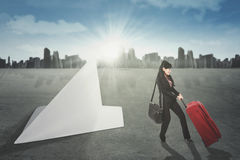 Female entrepreneur with paper airplane Stock Image