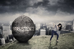 Female entrepreneur with persistence word on the hill Royalty Free Stock Images