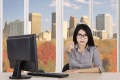 Female entrepreneur pointing finger at you Royalty Free Stock Photo