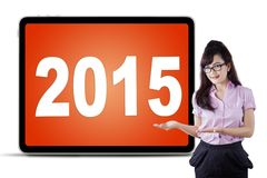 Female entrepreneur presenting number 2015 Stock Image