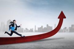 Female entrepreneur running on the arrow Stock Photo