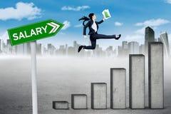 Female entrepreneur runs above salary graph Royalty Free Stock Photo