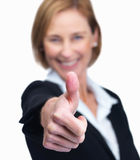 Female entrepreneur showing a thumbs up sign - Whi Stock Image