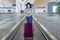 Female entrepreneur with suitcase on the escalator Stock Photos