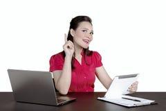 Female entrepreneur thinking something on studio Royalty Free Stock Images