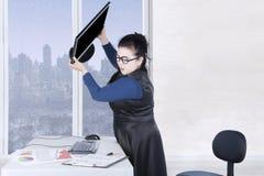 Female entrepreneur throws computer Royalty Free Stock Image