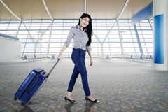 Female entrepreneur travelling with a suitcase Stock Images