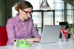 Female Entrepreneur working on Computer at modern Digital Office Royalty Free Stock Images