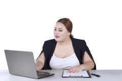 Female entrepreneur working on laptop Stock Images