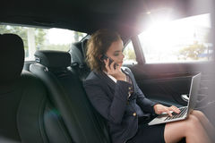 Female entrepreneur working during travelling to office Royalty Free Stock Photography