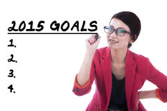 Female entrepreneur writes her goals Royalty Free Stock Photo
