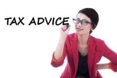 Female entrepreneur writes tax advice Stock Photo