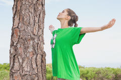 Female environmental activist in front of tree trunk Royalty Free Stock Photos