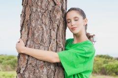 Female environmental activist hugging tree trunk Royalty Free Stock Photo