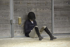 Female Equestrian. A female equestrian resting before a competition Stock Image