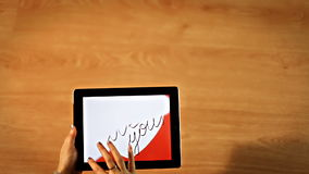 Female erasing white heart on tablet, I love you calligraphy, love is gone stock footage