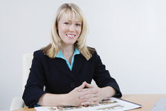 Female Estate Agent With Building Models Stock Images