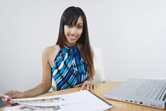 Female Estate Agent With Building Models And Laptop Stock Images
