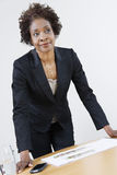 Female Estate Agent Leaning On Table Royalty Free Stock Photography