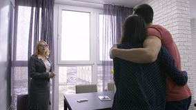 Female estate agent showing apartment to couple