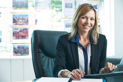 Female Estate Agent Working At Computer In Office. Portrait Of Female Estate Agent Working At Computer In Office Royalty Free Stock Image
