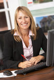 Female Estate Agent Working At Desk stock photo