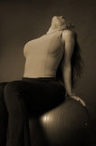 Female with excercise ball. Sepia female with excercise ball Stock Images