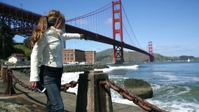 Golden Gate Bridge Tourist. Female Excited Pointing and taking pictures at Golden Gate Bridge stock video