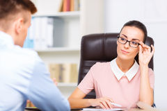 Female executive admires her office mate Royalty Free Stock Photography