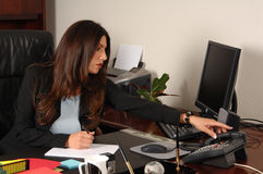 Female Executive Answering Phone Stock Photography