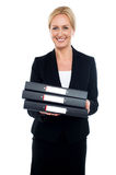 Female executive carrying business files Royalty Free Stock Photo