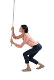 Female executive climbing the rope Royalty Free Stock Image