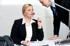 Female executive discussing business issue Stock Photo
