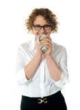 Female executive drinking coffee Stock Photos