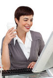 Female executive drinking a coffee at her desk Stock Photography