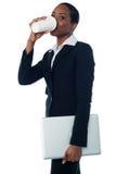 Female executive enjoying cold coffee Stock Photos