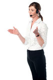 Female executive explaining, hands movement. Attractive female support staff explaining solution to customer Royalty Free Stock Photo