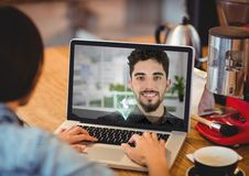 Female executive having video calling with colleague on laptop Royalty Free Stock Images