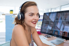 Female executive in headset at his desk in office Stock Photo