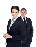 Female executive with her colleague at the back Stock Photos